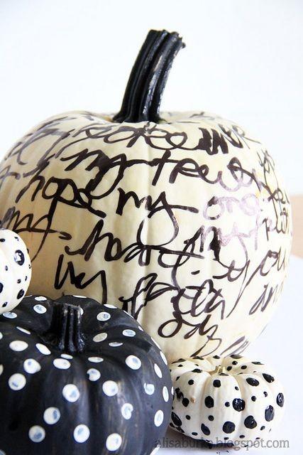 White pumpkin with black script writing - LOVE! -...