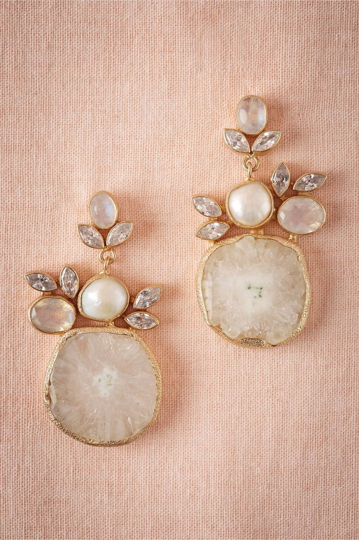 Druzy drop earrings from BHLDN. The organic shapes...