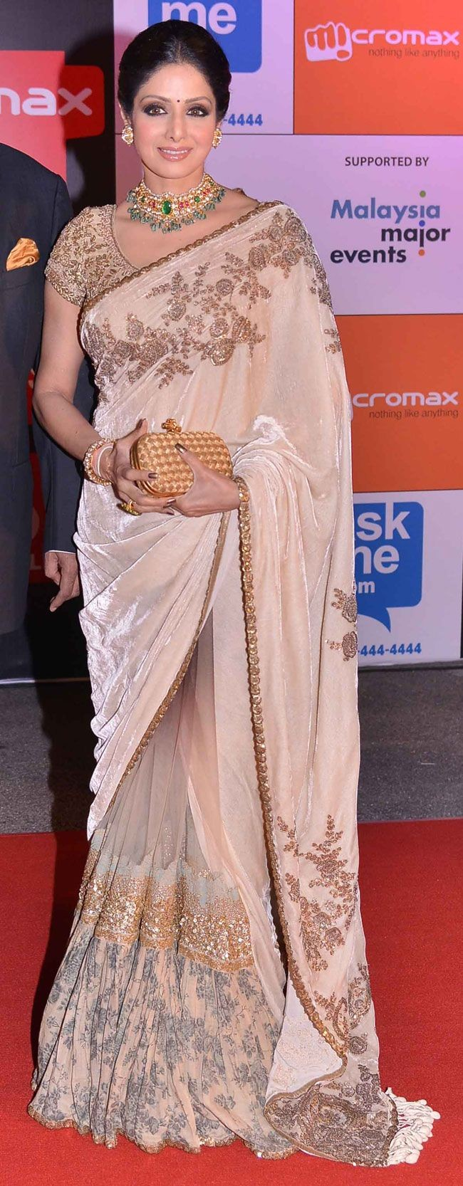 Sridevi looked beautiful in a beige saree with gol...