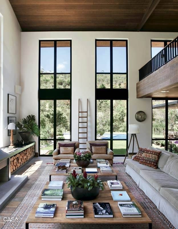 open atrium with patterned rug, two armchairs, sli...