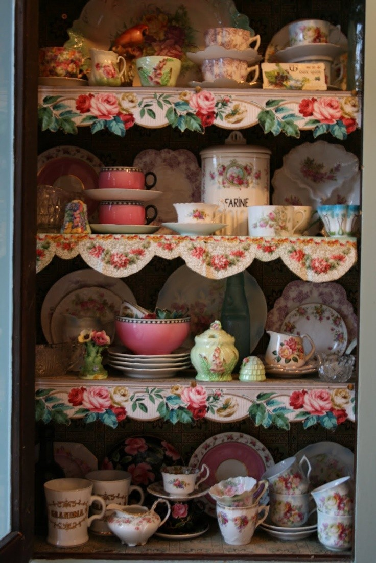 Use cut out vintage wallpaper for shelf trim. I wo...