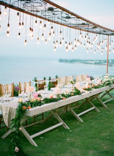 love this lighting: http://www.stylemepretty.com/2...