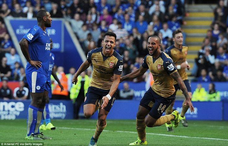 Arsenal forward Alexis Sanchez (left) celebrates a...