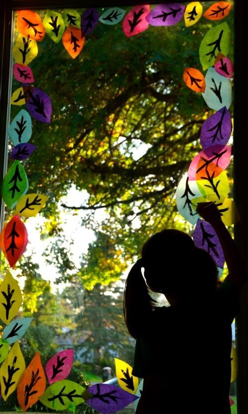 Decorate the windows for Fall  ( with kids made le...