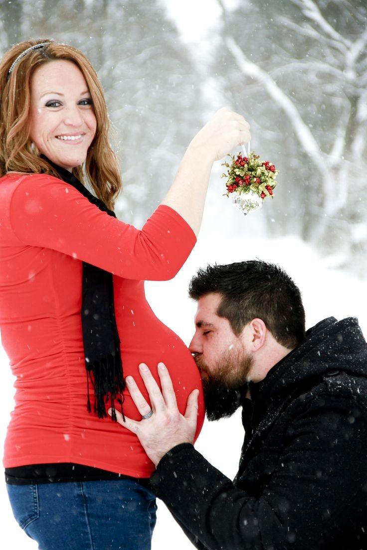 Maternity photo shoot outside winter snow falling...