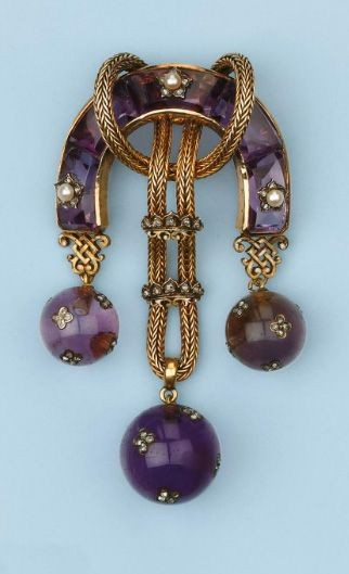 A horse-shoe shaped body set with amethysts, pearl...