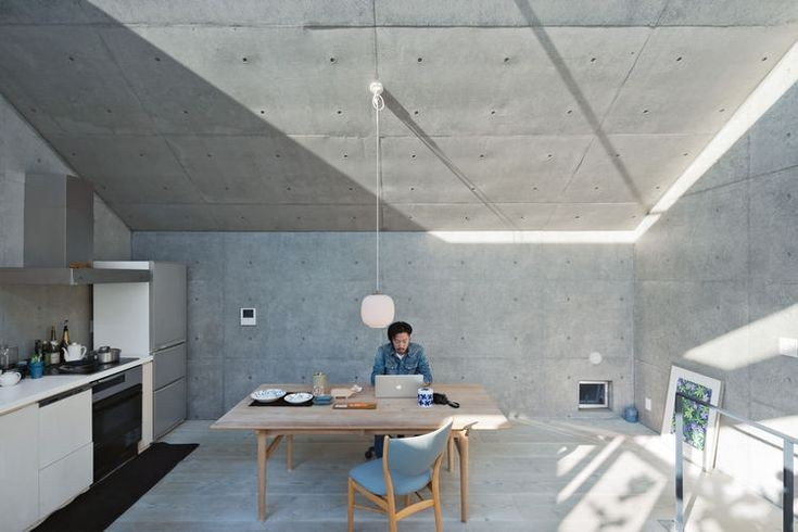 open plan concrete home in japan. Nakada works fro...
