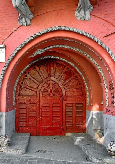 Bright red wooden door in Kiev, Ukraine~